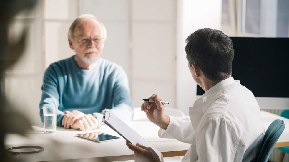 Man Speaking With Patient